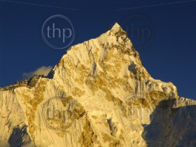 Snow capped peak Nuptse sits just next to Mt Everest in the Himalaya, Nepal