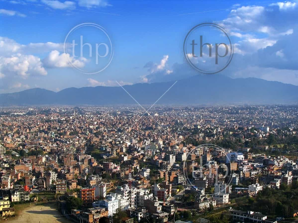 Endless sprawl of Kathmandu, Nepal, with mountains behind