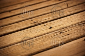 Old timber decking showing its age with nails lifting