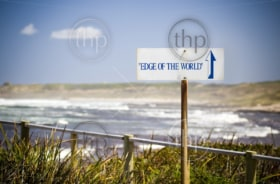 A sign saying Edge of the World points out to sea