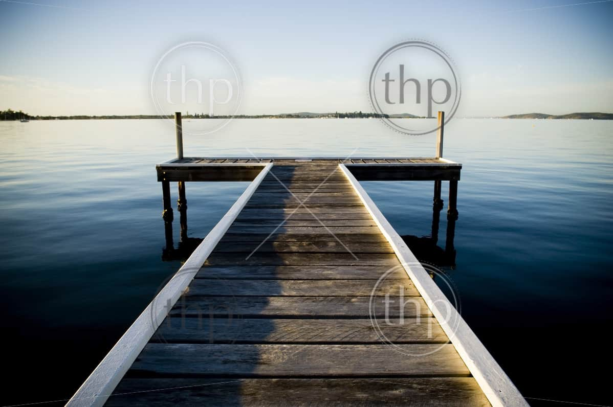 Wooden pier or jetty stretches out into an idyllic ocean