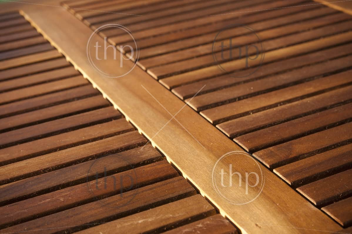 Thin timber slats form repeating patterns on a table top