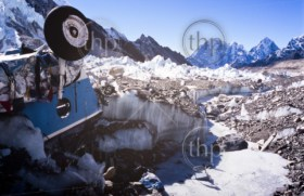 Crashed helicopter frozen in ice at the Mount Everest Base Camp, Nepal Himalaya