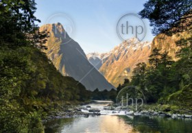 Spectacular mountain peaks and valley with river flowing through it