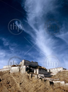 Tibetan monastery, Gyantse Dzong, built high on a hill with deep blue sky behind