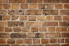 Brick wall in old red bricks in bad condition