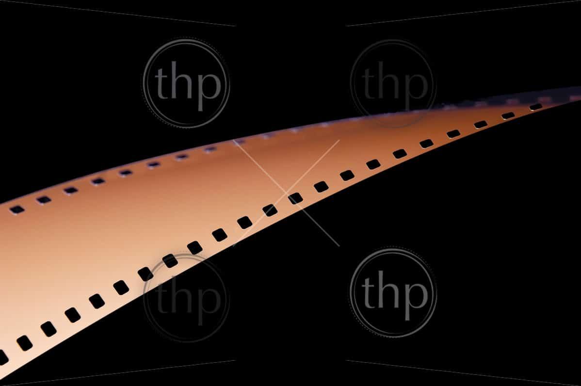 Abstract details of 35mm film strip on black background