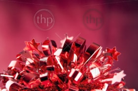 Bright red gift wrapping on a blurred red background