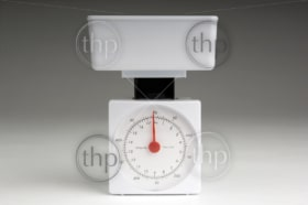 New white kitchen scales over a gradient background