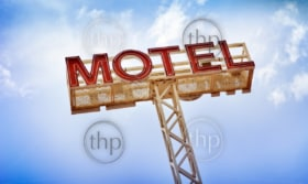 Classic motel sign against blue sky