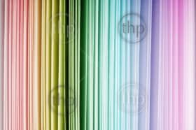Rainbow color spectrum of thick paper ends from red to purple
