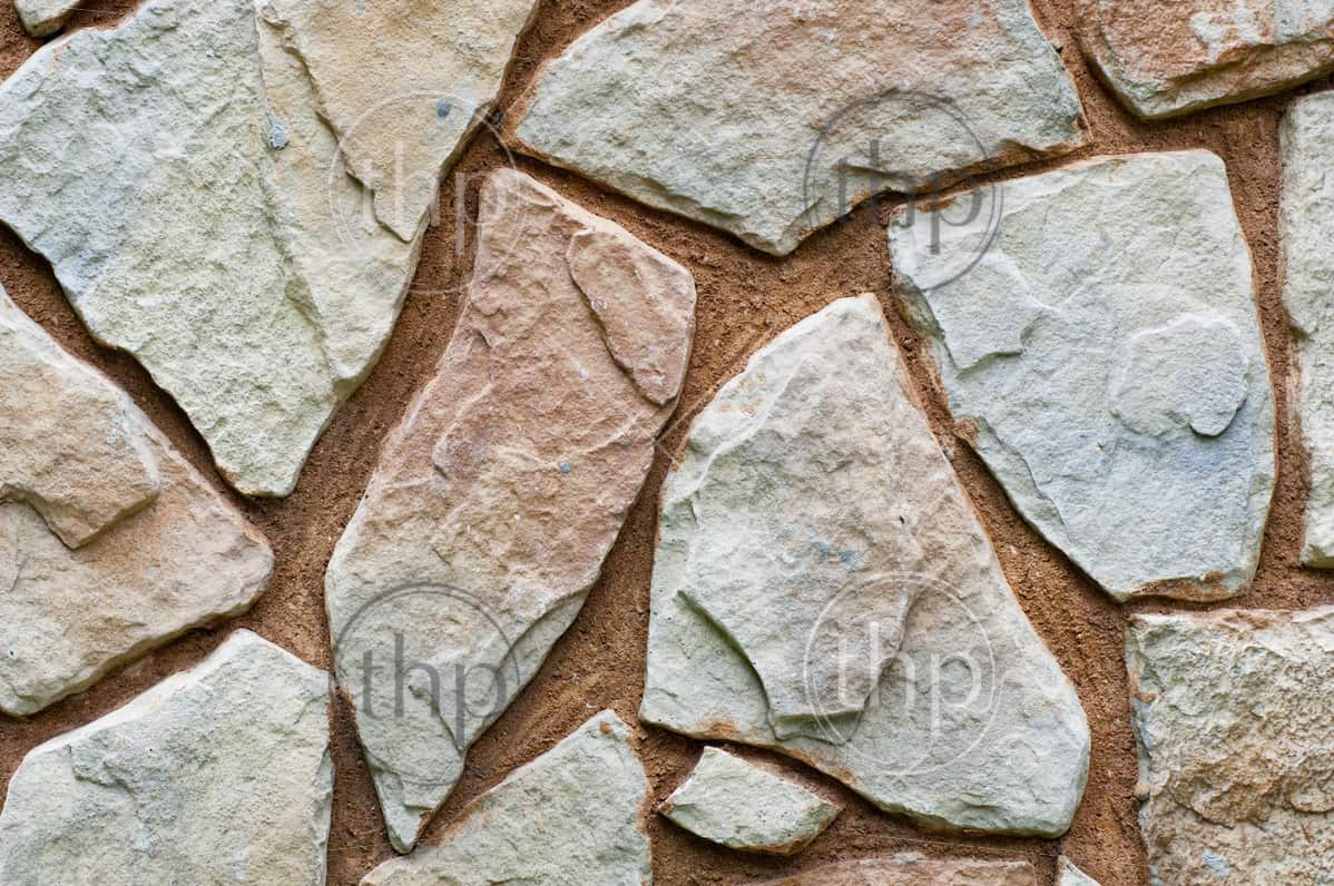 Stone wall background with odd shapes and sizes