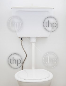 Generic white household toilet on white wall