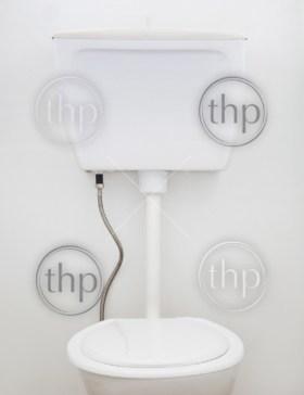 Generic white household toilet on white wall