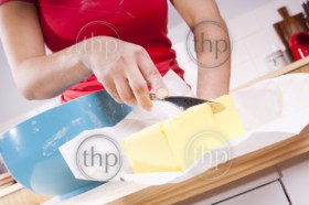 Woman cooking in the kitchen with bright bowls