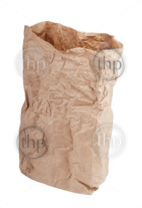 Brown paper bag crushed and crumpled isolated on white