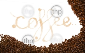 Coffee written as a word in coffee stains with coffee beans around isolated on white