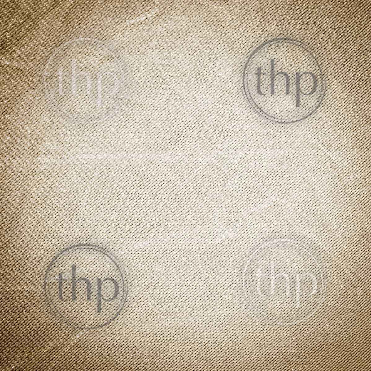 Creased and crumpled sepia fabric texture as background