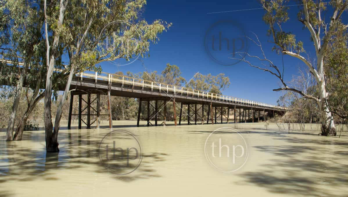 Darling River, in outback Australia with the highway crossing the bridge above it