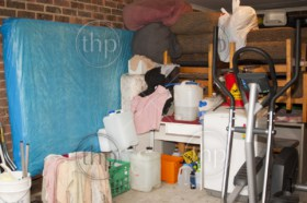 Suburban garage used as storage full of household items and mess