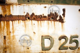 Old rusted metal background with lettering