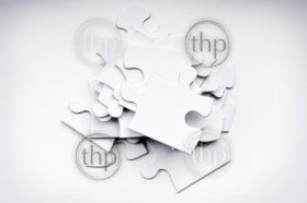Jigsaw puzzle pieces in a pile out of order
