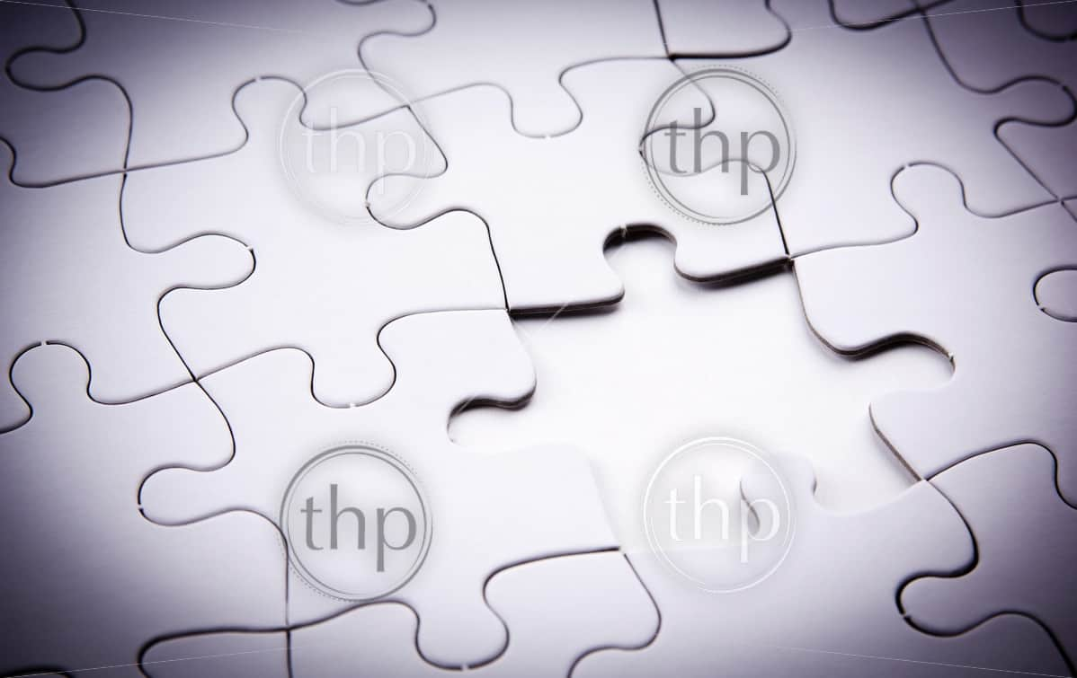 Jigsaw puzzle with a key piece missing to link it together