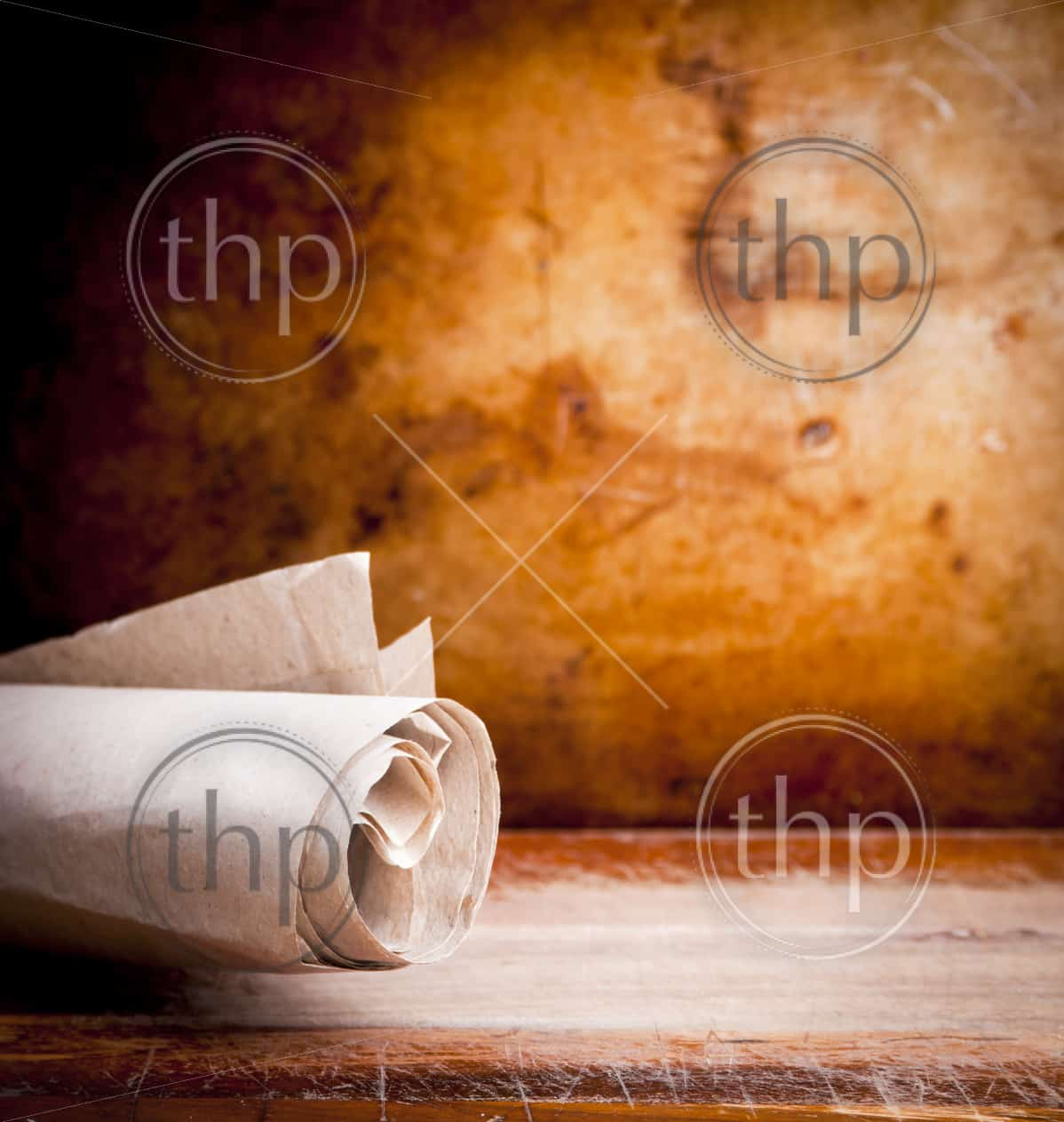 Old paper parchment scroll rolled up with a vintage background with copy space