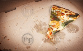 Pizza slice last one left in the pizza box