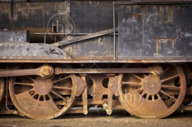 Old train wheels and parts rusting away