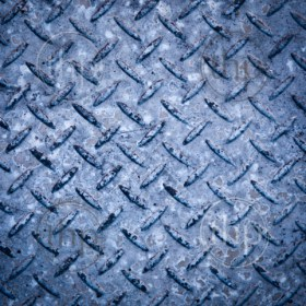 Background texture of checkerplate steel imprint in concrete
