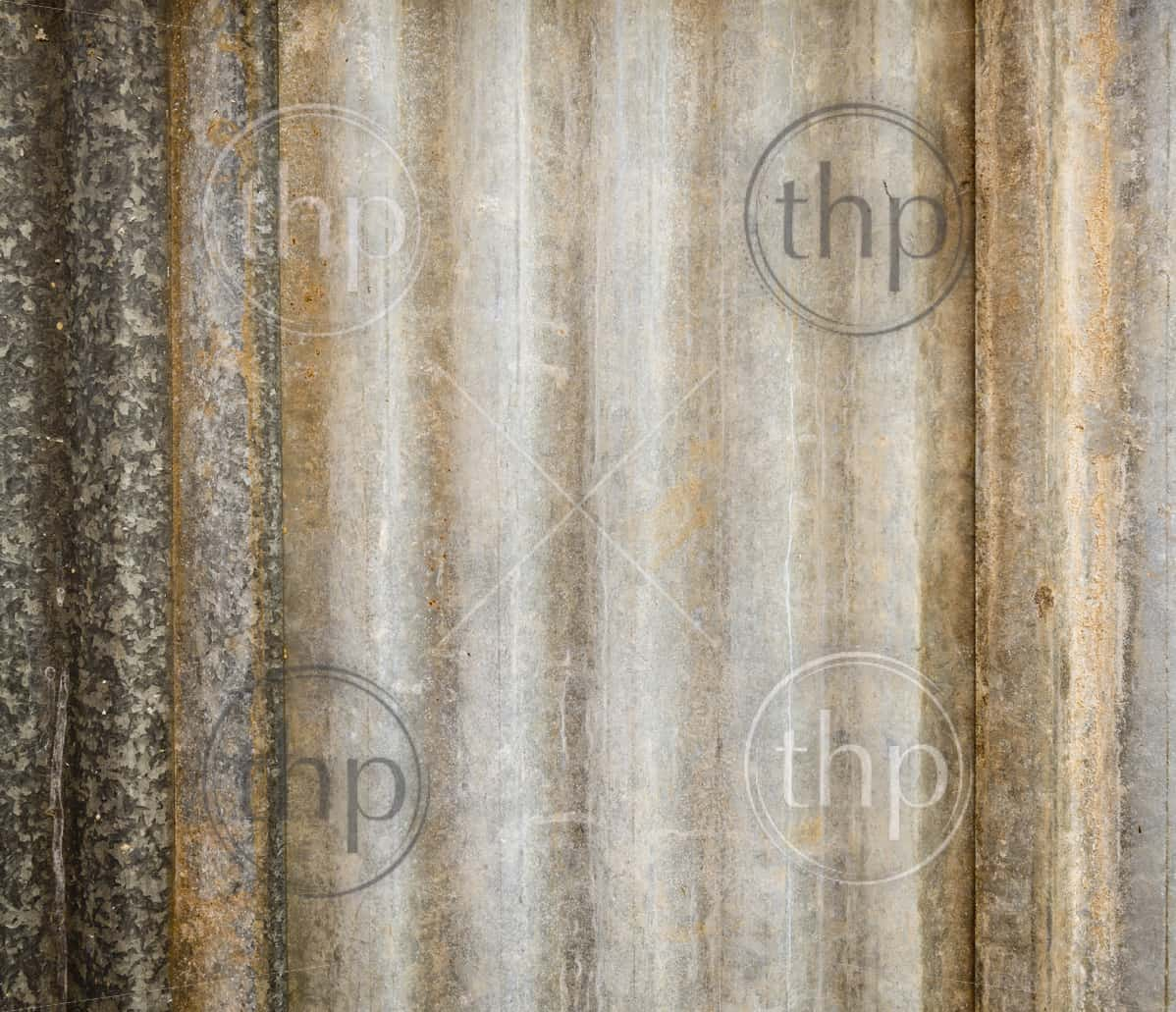 Background texture of corrugated iron sheets with rust and wear