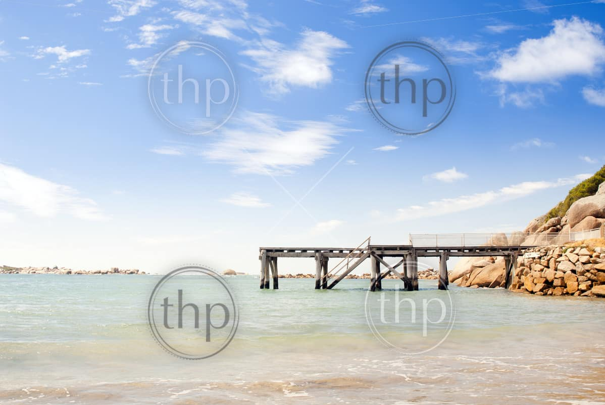 Jetty stretches out into the clear blue water in South Australia