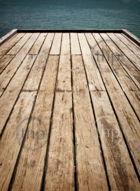 Wooden timber planks with ocean water in the distance