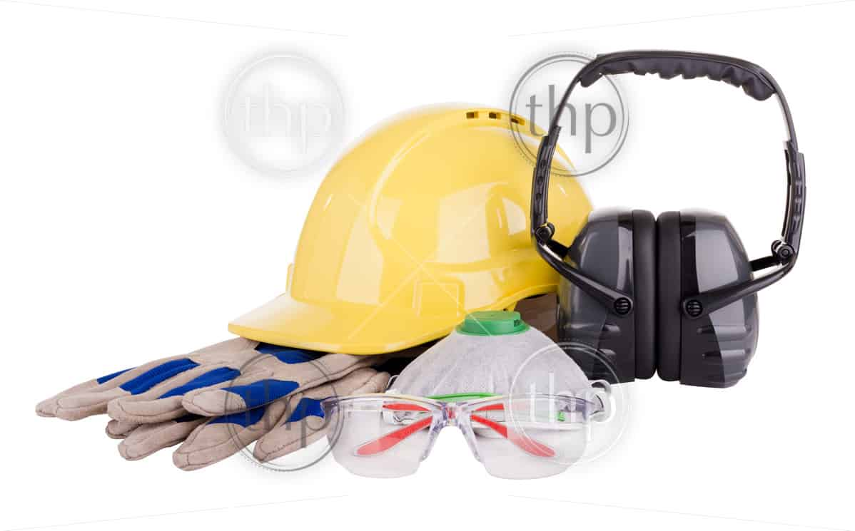 Safety equipment or PPE - personal protective equipment - with hard hat, safety glasses, gloves, face mask and earmuffs isolated on white