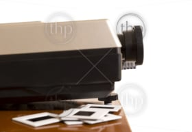 Retro slide projector with slides isolated against a white background