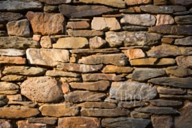 Stone wall built from stones and rocks of different sizes
