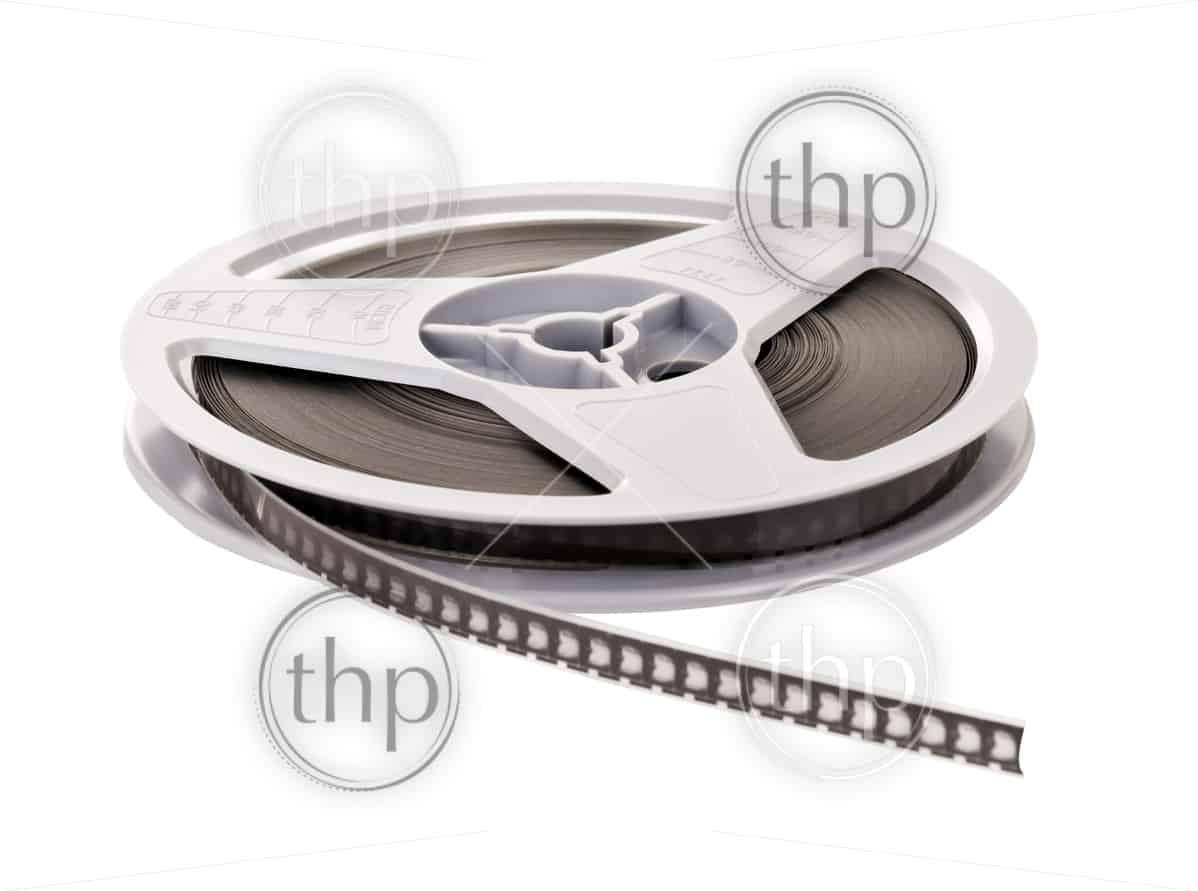 Vintage Super 8 film reel isolated on white background