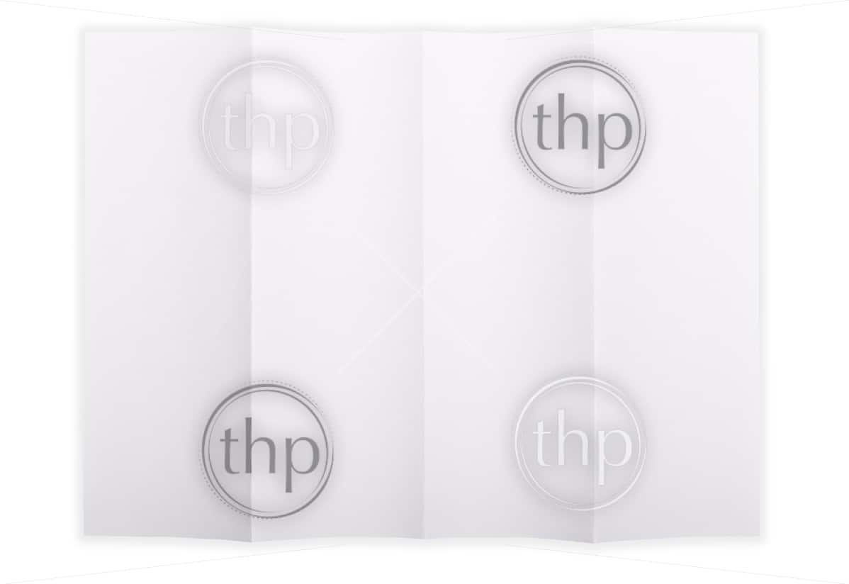 White paper sheet folded in 4 quarters isolated over a white background