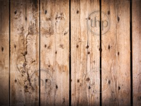 Timber background made of old, rough wooden planks with nails