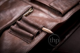 A man's business briefcase bag, leather satchel with a pencil