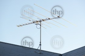 Digital TV aerial or antenna on top of a house