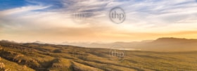 Panoramic wide view of sunset mountain landscape in stunning golden light in the Grampians, Australia