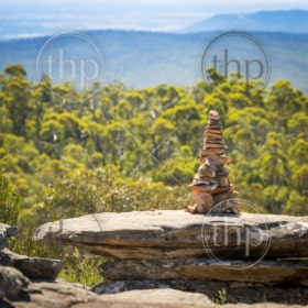 Pile of stones in perfect balance in shallow focus with natural background