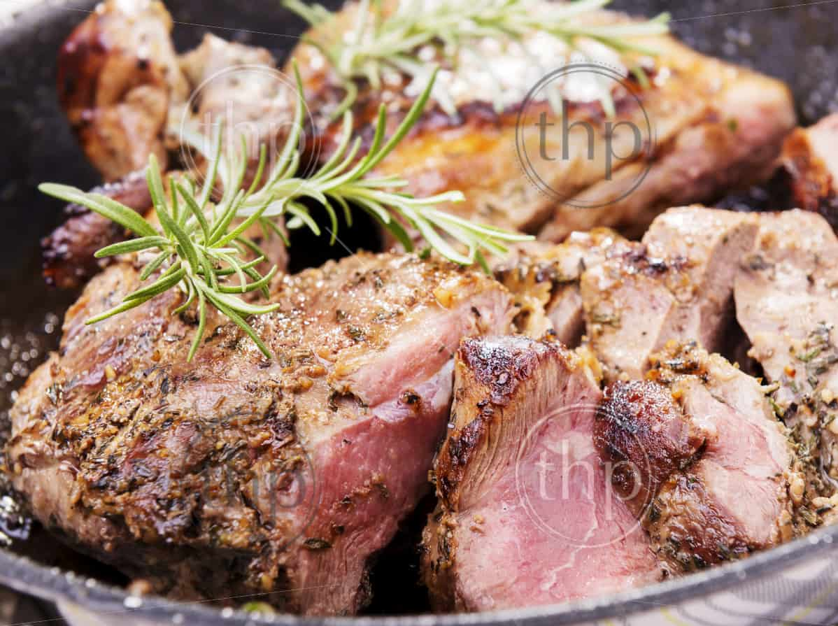 Rustic roast lamb with pan juices and rosemary