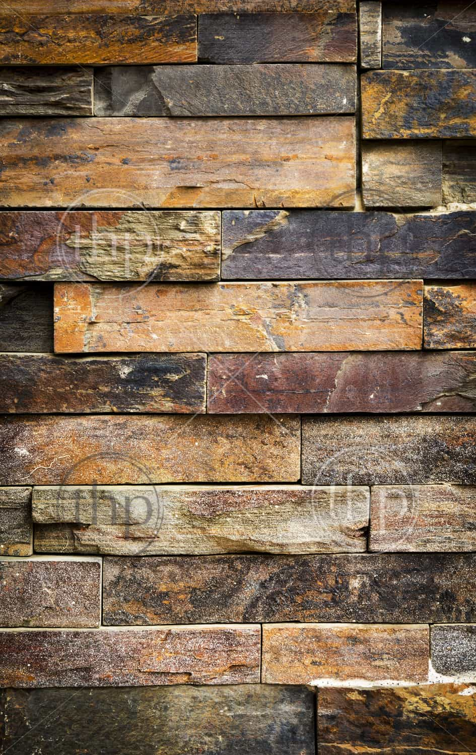 Stacked Stone Cladding Building Facade For Background Texture