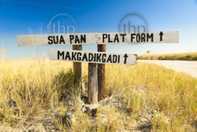 Makgadikgadi Pan sign in Botswana, Africa pointing to the huge salt flats of the Makgadikgadi Pan