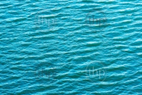 Ocean waves with gentle ripples form a background