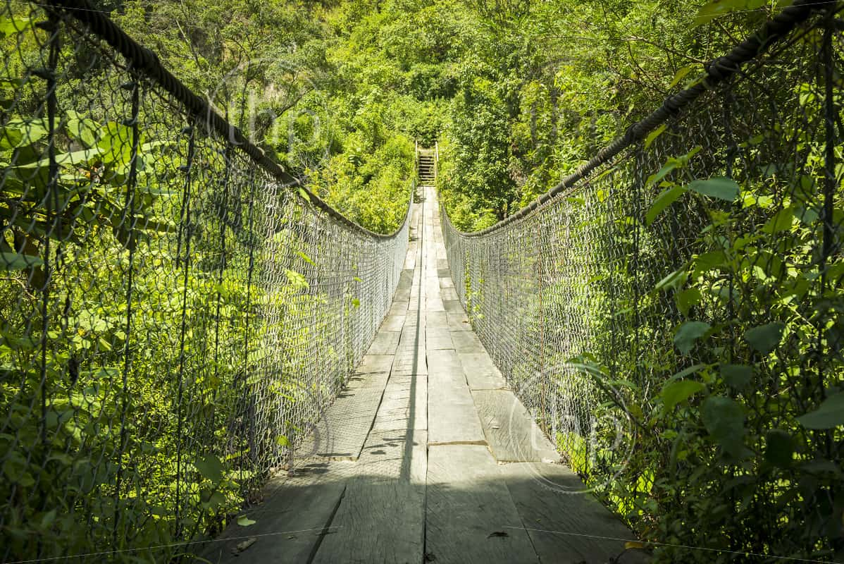 Wooden suspension bridge over river in Panajachel, Guatemala, Central America