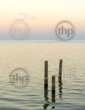 Ocean landscape with minimalism design of wooden pylons